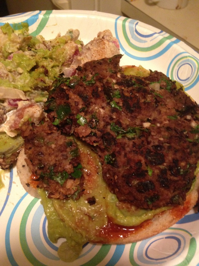 Mexican Black Bean Burger (with vegan potato salad, topped with BBQ sauce and guacamole)