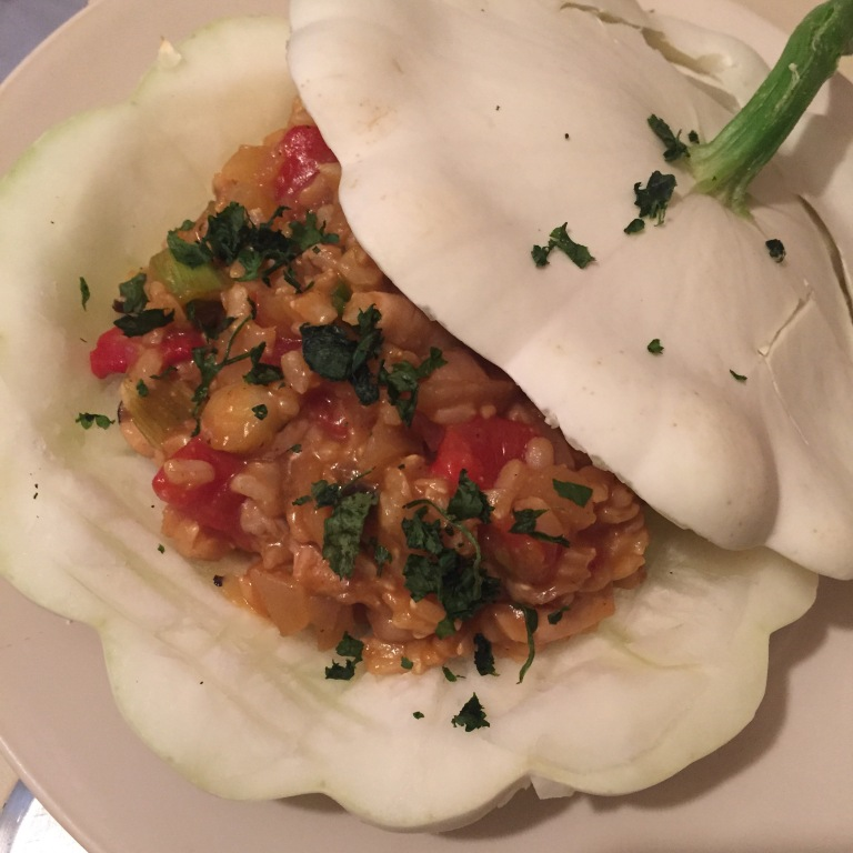Pattypan squash stuffed with brown rice, straw mushrooms, red pepper, cilantro, garlic, soy sauce, hoisin, ginger and garlic.